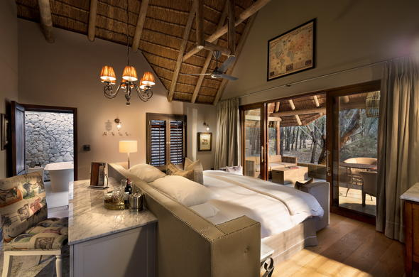 Sleep comfortably in the luxury cottage at Ngala Safari Lodge.