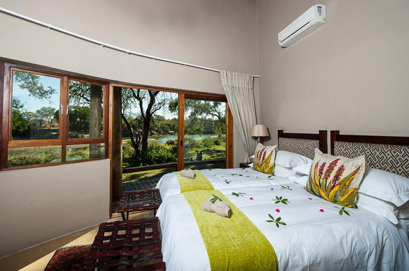 Family chalet accommodation at Simbavati River Lodge.